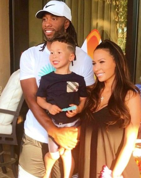 larry fitzgerald with her wife and child
